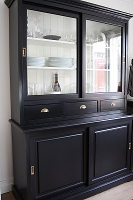 Black window cabinets with white backs
