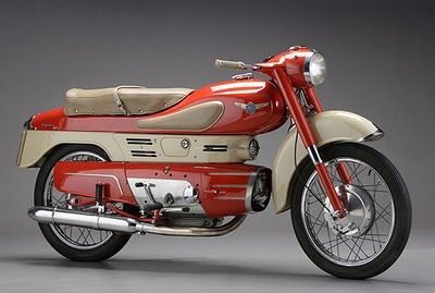 This super cool postie bike Is on my wishlist!, with the red color choice of speed and the creme separating the color it makes for an awesome sight. the structure is a little bulky but it likes it has a jet under neath it.