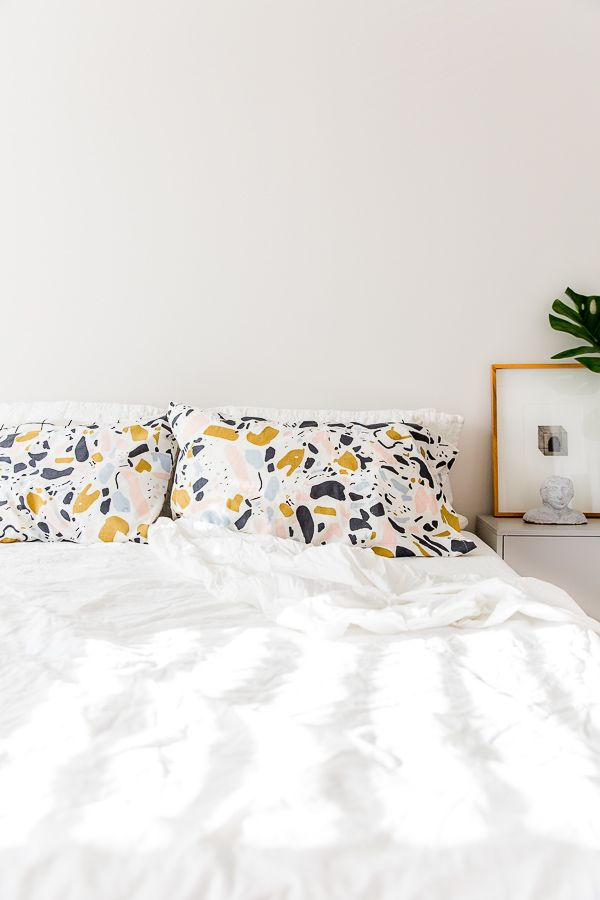 White bedroom with a pop of pattern