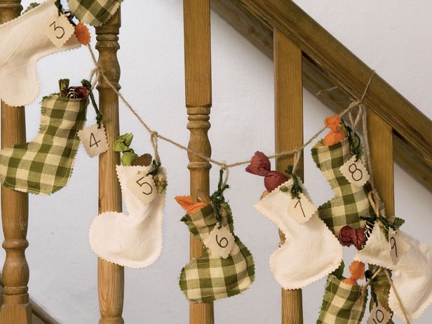 Stocking Advent Garland Tied On Stairway Banister - I think this would be cute in a contemporary style too.