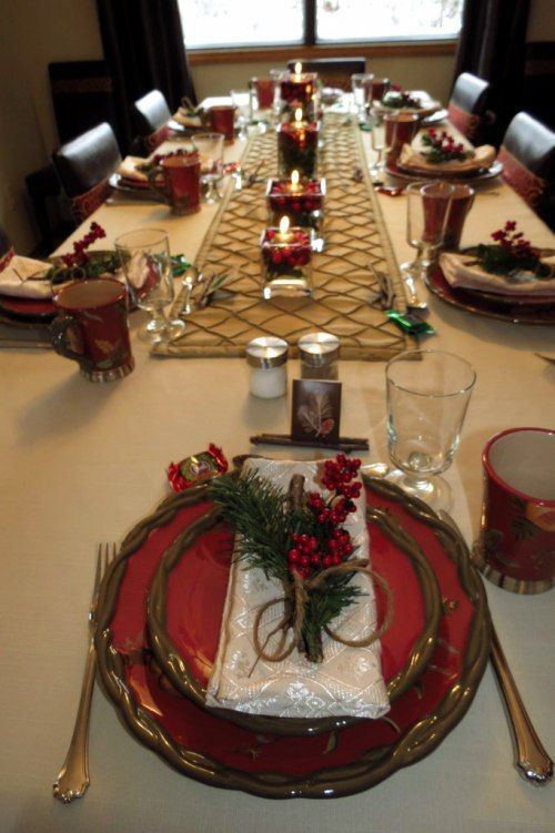 Christmas table setting with twig place cards and berry and garland place setting.