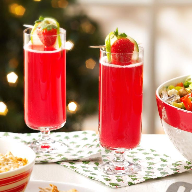 Pink Sparkling Wine Punch Recipe -A long-standing tradition in our home, this sparkling punch makes spirits bright. Garnished with fresh strawberries and lime, it makes a colorful Christmas cocktail.—Karen Kuebler, Dallas, Texas