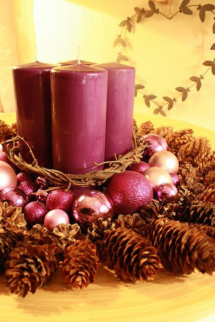 Change  the colors for a fall candle center piece with pine cones.  Decorate with nuts and acorns instead of Christmas balls.