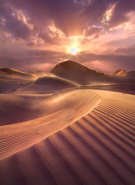 Breathtaking sand dune desert during sunset hour... if you look closely the wind blows the sand dust around... must be tough with the heat to take this picture :) #dubai #uae