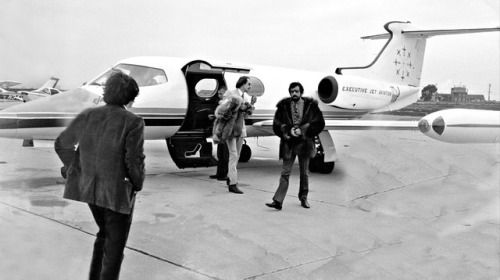 Lou and John, are about to make the best festival of all time. 🌸 Lou Adler & ''Papa'' John Phillips meet Jann Wenner at the airport | by Fred Arellano,