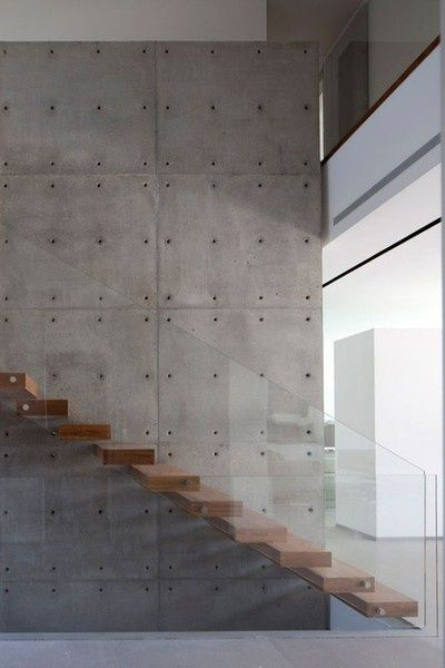Pin 7: The timber floating stairs and glass balustrade are great additions to the concrete wall panels giving it a seamless, somewhat minimalist look. The exposed studs on the concrete panels creates an artwork like effect which livens up the open space.