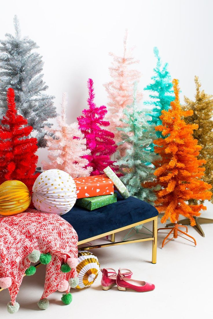 """Why have just one tree when you can have a rainbow of them instead?! Clearly I use the holidays as #myreason for going all out when it comes to decorating. It's the one time when no one ever questions you, ha! More is more in my book, and @athomestores is totally feeding the habit. #sugarandcloth #sponsored"""