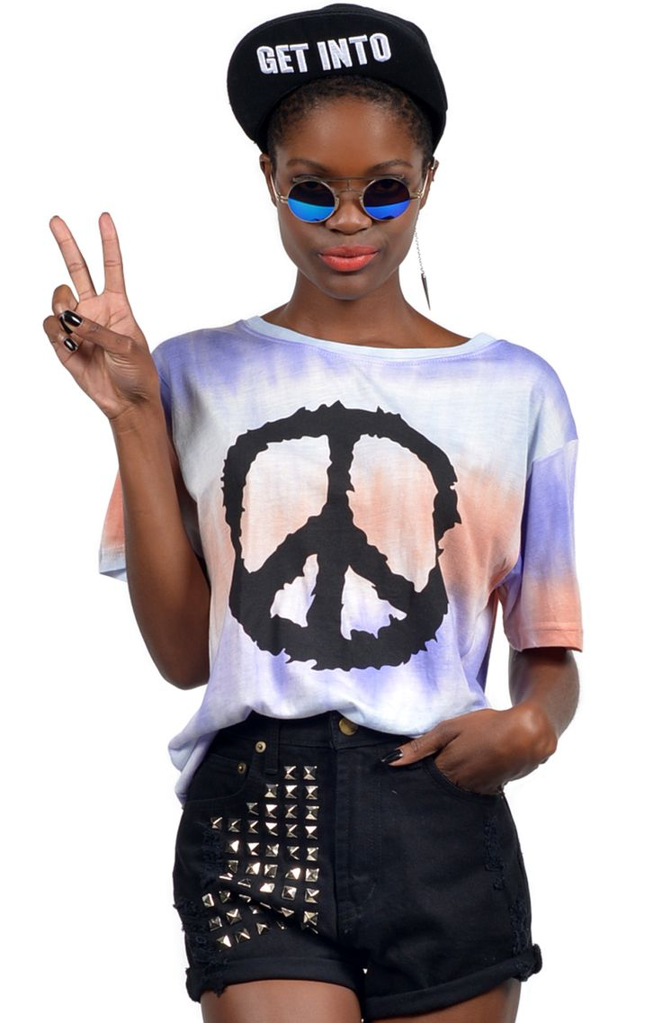 Peace, love and tie dye! Rad tie dye t-shirt with black peace sign print. Oversized, loose fit. Pair with your favourite skinnies, lace up boots and monochrome cardigan. Length: 64cm. Width: 43cm. Available online now at www.ilovethelot.com