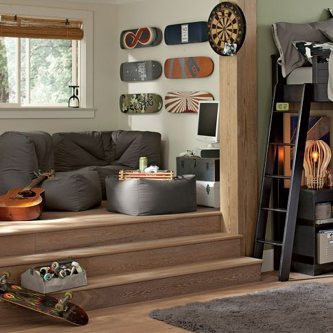 love the steps in the room! fabulous idea for rec room, to create a cozy nook for reading or conversation or watching movies (big screen on opposite wall)