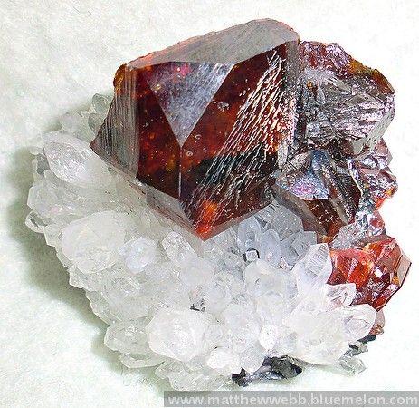 """exclusiveminerals > Sphalerite on quartz, China; c 2 3/4"""" across > Sphalerite on quartz"""