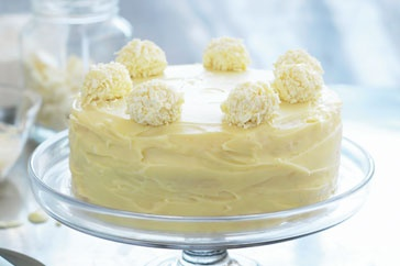 Layers of moist white chocolate cake smothered in rich ganache and decorated with Grand Marnier truffles – the perfect centrepiece for any Easter celebration.