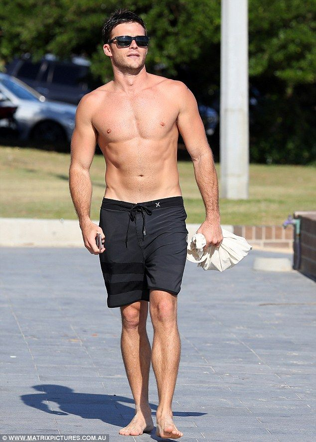 Sun's out guns out! Scott Eastwood, 30, had heads turning as he strut around shirtless along Sydney's Bondi Beach on Thursday