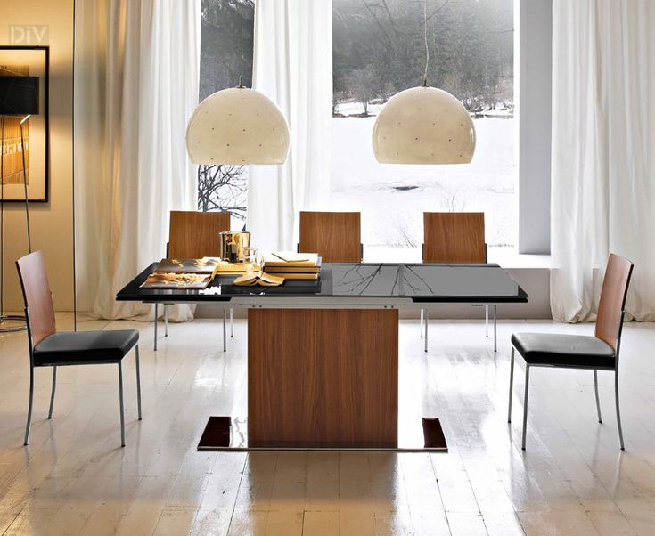 Minimalist Modern Calligaris PARK Extendable Glass Top Dining Table With Black Chairs And Two White Pendant Lamps