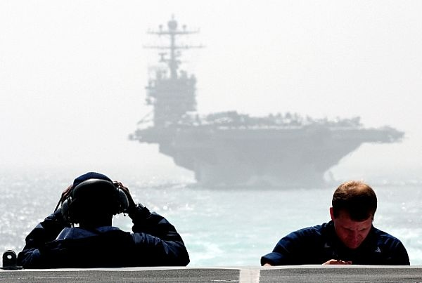 STRAIT OF HORMUZ (March 12, 2012) Boatswain's Mates 2nd Class Kenneth Adams, left, and Aaron Turner stand watch on the fantail of the Arleigh Burke-class guided-missile destroyer USS Sterett (DDG 104) as the ship escorts the Nimitz-class aircraft carrier USS Abraham Lincoln (CVN 72) through the Strait of Hormuz. (U.S. Navy photo by Mass Communication Specialist 3rd Class Tim D. Godbee/Released)