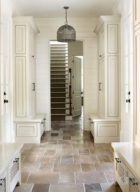 Mudroom with separate lockers and natural stone floor | Jessica Bradley