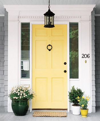 Perfect color idea for exterior; medium gray body, white trim, yellow door