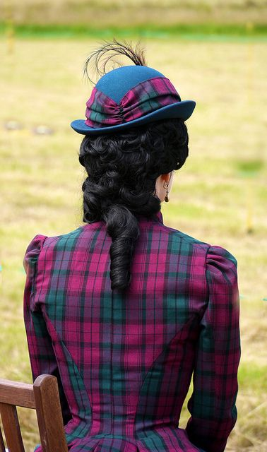 Elegant dress and hat with an unusually bright Tartan pattern