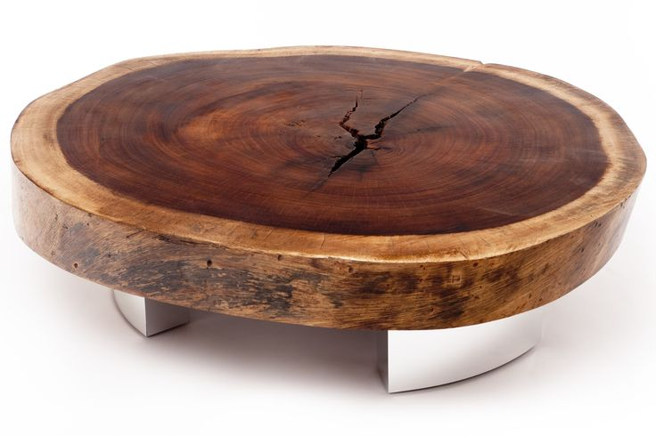 This round coffee table is made of a crosscut of reclaimed Tamburiuva wood on natural finish, with its contemporary metal base made of hand polished aluminum. WOW!!!