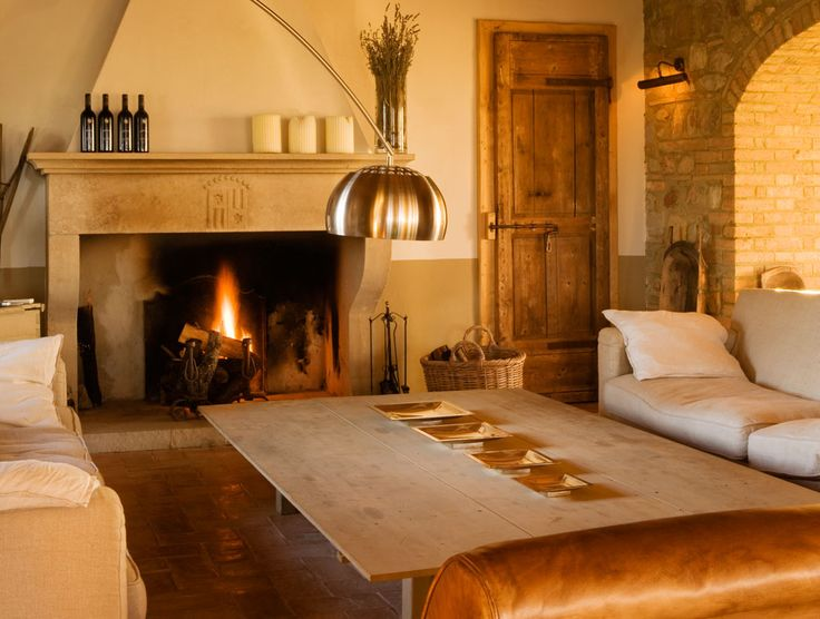 Fireplace With Stainless Steel Arch Lamp And Rustic Door Also Leather And White Sofa