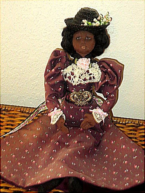 One of my Victorian cloth original lady dolls.  Has price greatly reduced because of sun exposure on skirt.  She is wired, needle sculpted, wears underclothing, mock leather boots.  Has breasts and bustle.  Trimmed with antique lace...Sold on website http://barbspencerdolls.com