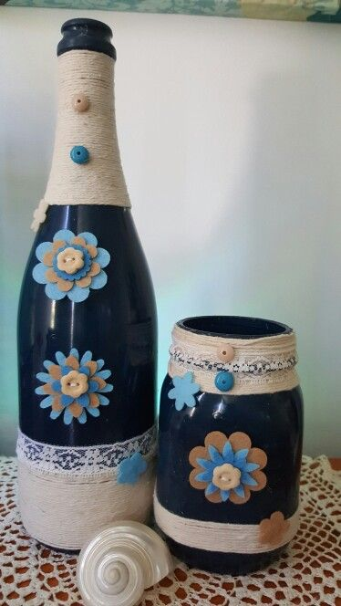 Wine bottle craft twine dark blue paint felt flowers and lace. Cheap to make and loads of fun and abit of imagination.
