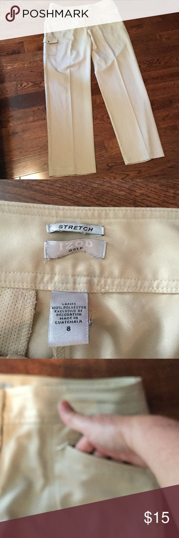 Ladies Izod Golf Pant Ladies Beige Izod Stretch Golf Pant Size 8. 100% Polyester. Worn only once. Zipper, Hidden Hooks and Button Closures. Two Zip-up slit pockets in front and a cargo style pocket on right leg. Right back slit pocket (Still stitched) Izod  Pants Trousers