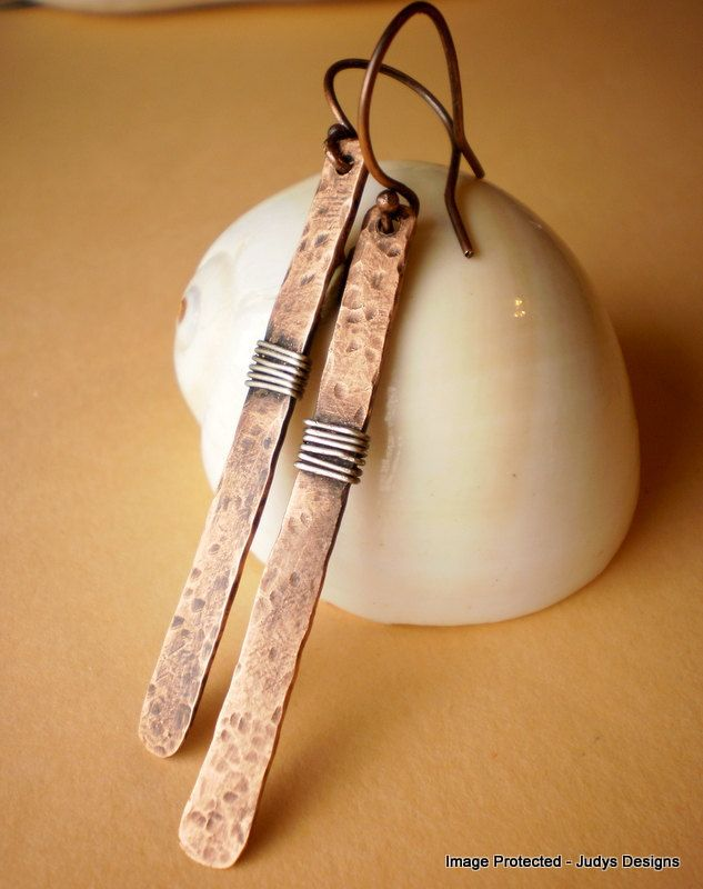 Copper hammered sterling silver earrings, handmade, long, stick style, wire wrapped. $18.00, via Etsy.