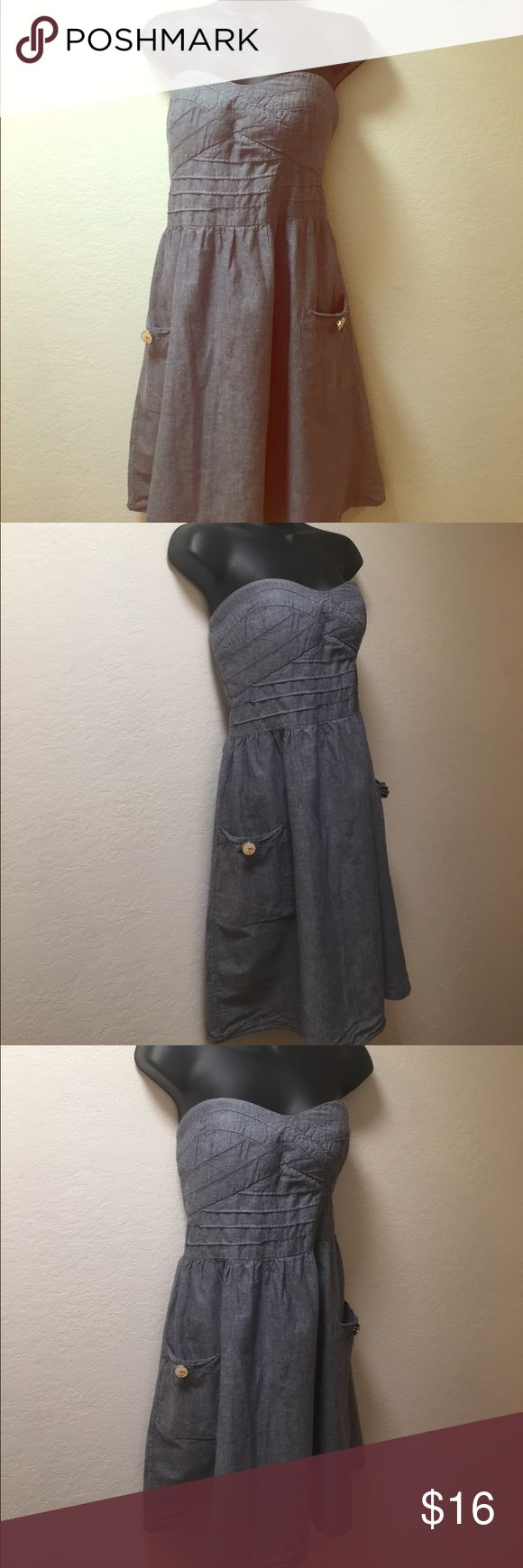 """Woman's Cute Strapless Dress Size 13 Woman's Cute Strapless Dress material: Cotton. Lining is Polyester. Has two pockets with cute buttons. Care Label: Machine wash cold. Size 13.  Fits waist 32""""inches Dress Length is 30 inches. Thank you for looking. Happy Poshing😊 Dresses"""