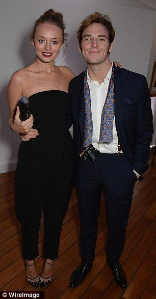 Glowing couple: Sam, who stars as Finnick Odair in the film, posed with wife Laura at the Hunger Games party (left) and the Vanity Fair and ...