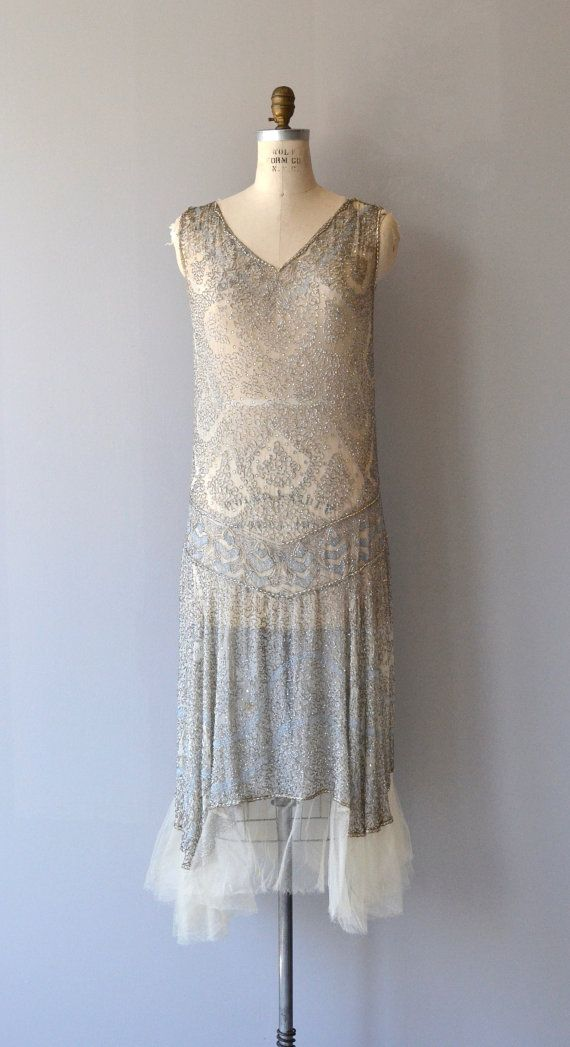 Otherworldy vintage 1920s silk dress entirely covered in silvery beading with subtle teardrop pattern, identical from back to front with V neckline, classic 1920s shape and airy tulle trimmed hem