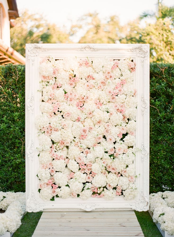 Framed, Rose & Hydrangea Wall at Ceremony | Photography: KT Merry Photography. Read More: http://www.insideweddings.com/weddings/a-gorgeous-and-elegant-outdoor-florida-wedding/536/