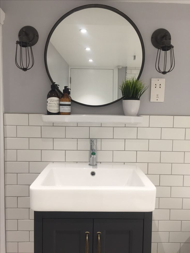 Shame about shaver socket - would usually hide this within the vanity cabinet.  Apart from that (grrrrrr!), looks good!  Vauxhall apartment.  White subway tile, mapei light grey manhattan grout