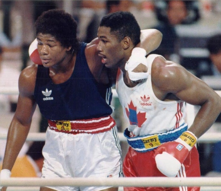 October 2, 1988. Canadian Lennox Lewis, right, hold up Riddick Bowe from New York, NY, after defeating him by technical K.O., in the superheavyweight (200+ pounds) class at the 24th Summer Olympic Games in Seoul, South Korea. {When Olympic Boxing was still GREAT!}