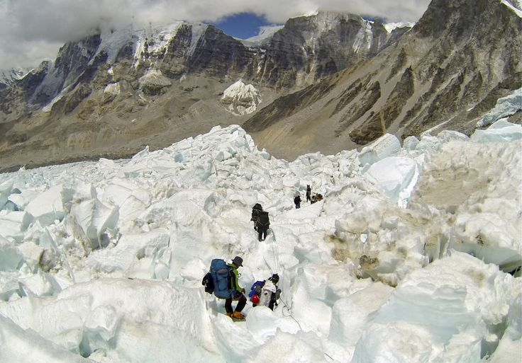 Climbers from various countries descend Khumbu Icefall on their way back to Base Camo on May 22, 2013 after summiting Mount Everest . May is the most popular month for Everest climbs because of more favorable weather. Earlier this month, an 80-year-old Japanese man Yuichiro Miura became the oldest conqueror of Mount Everest and Raha Moharrak became the first woman from Saudi Arabia to scale the peak. (Pasang Geljen Sherpa/Associated Press) #