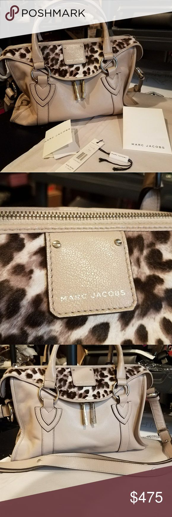 Authentic MarcJacobs Beige Leather Animal Print Ha Authentic MarcJacobsBeige Leather Animal Print Handbag Medium Sz. Overall Gently used comes with Tags. Please review all pictures. Happy Bidding. Pony Hair Marc Jacobs Bags Crossbody Bags