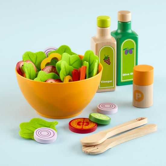 Why not start your kids on healthy eating at a young age.  Wooden salad set from The Land of Nod