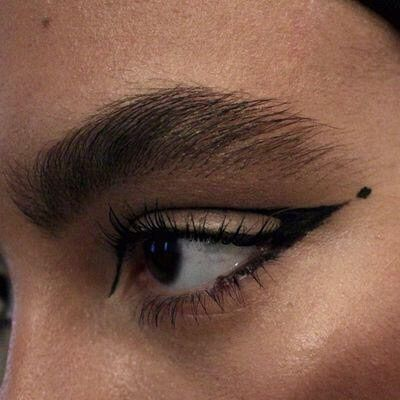 Such a gorgeous thick brow! And liner that works with her eye shape perfectly.