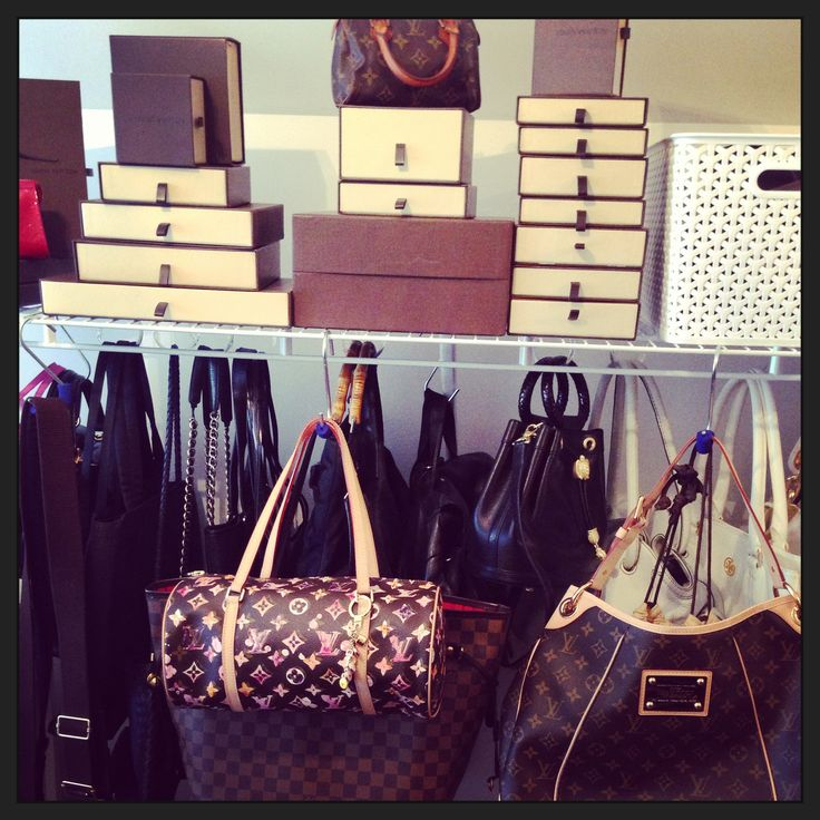 Louis Vuitton purses on closet hooks
