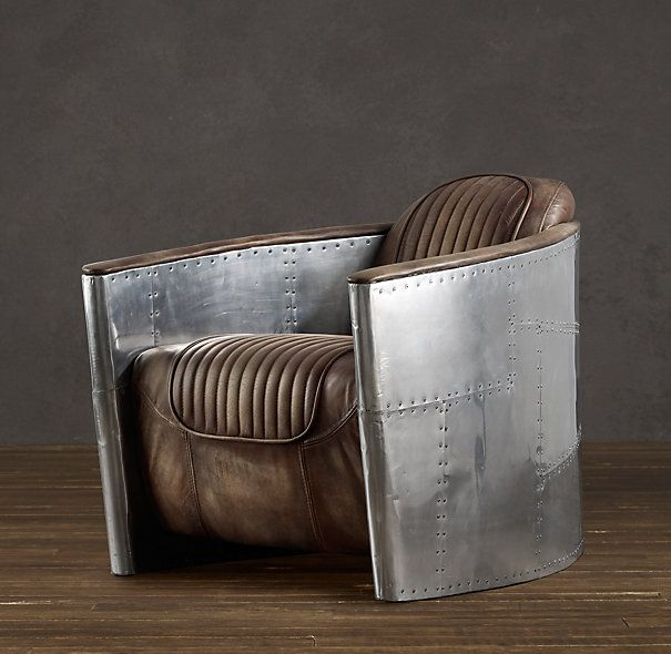 AVIATOR CHAIR $1400 --- Inspired by World War II fighter planes, our chair's aerodynamic curves are hugged in aluminum accented with exposed steel screws, the seat swathed in leather with the softness of a vintage bomber jacket. A low seat and raked back give it true flyboy swagger. #chair