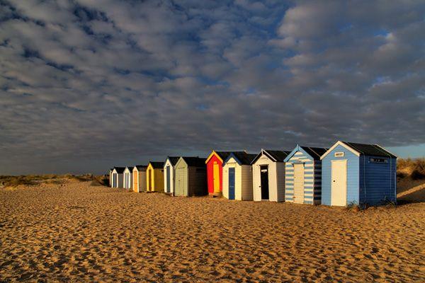 colourful beach huts, suffolk, england