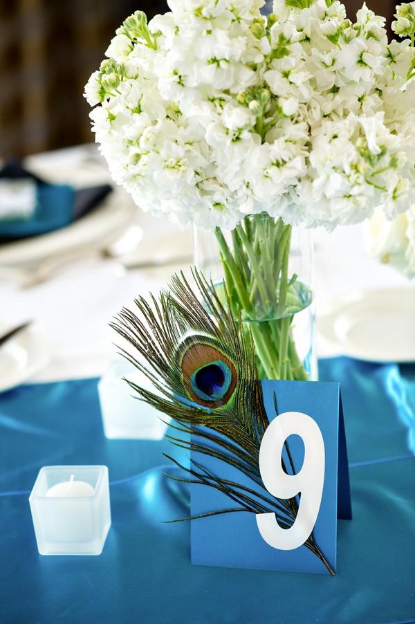 real interfaith peacock wedding table number  www.themodernjewishwedding.com