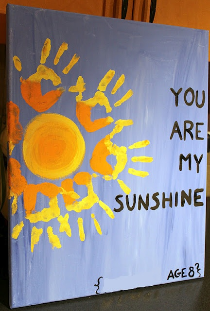 "painted ""you are my sunshine"" on our canvas and added names and ages."