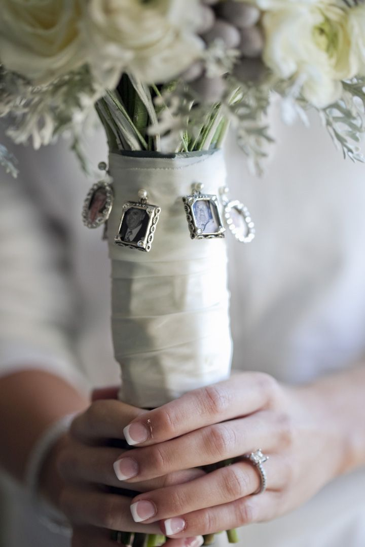 Love the little photo frames pinned to this...like people are helping you walk down the aisle. Very special. :)
