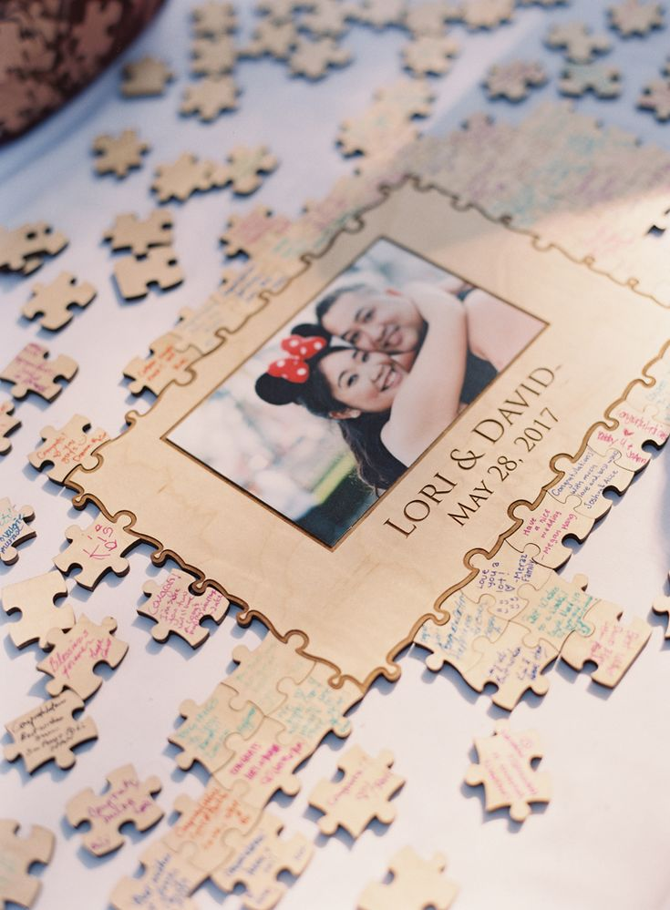 Unique wedding guest book ideas: Have your guests sign puzzle pieces! (Caroline Tran Photography)