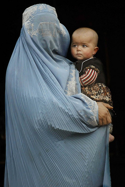 A mother dressed in burqa holds her child, Parwan province, Afghanistan - by Olivier Matthys, Belgian