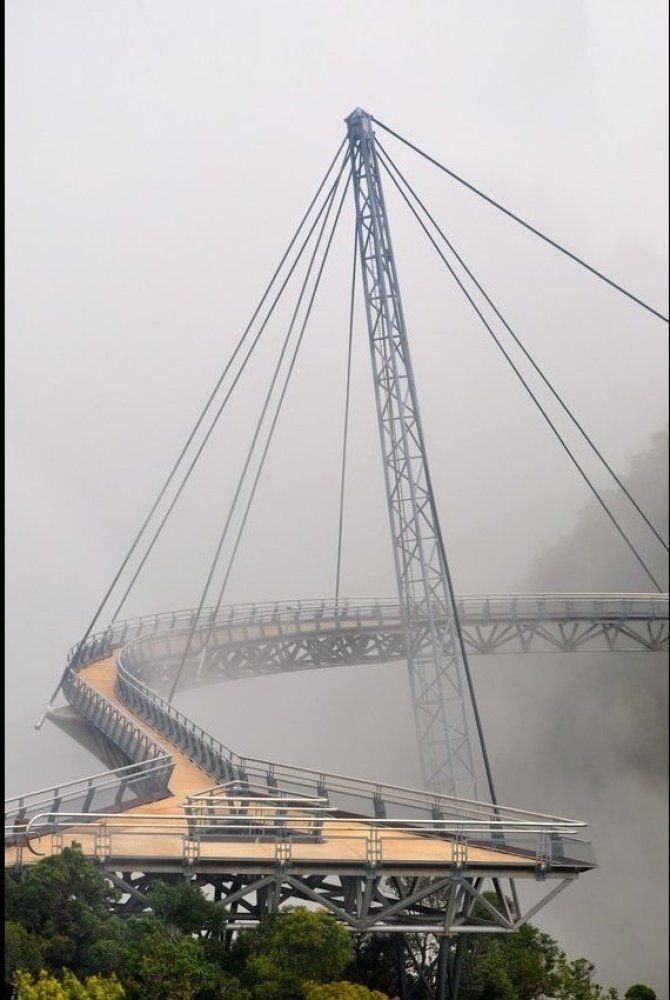 Trippy: 10 Truly Terrifying Bridges-Langkawi Sky Bridge - MalaysiaVisitors to this bridge will need to take a cable car up to the top as it's a full 2,000 feet above sea level. Once there, spectators can marvel at the panoramic view of the mountains and Andaman  Sea below