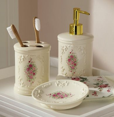 Love this victorian looking rose bathroom set. (soap/lotion dispenser, soap dish, toothbrush holder)