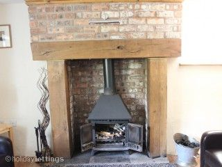 oak fire surround and slate(?) hearth