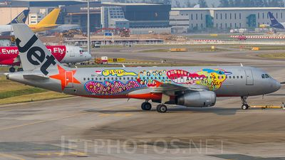 Jetstar Asia Airways (SG) Airbus A320-232 9V-JSH aircraft, painted in ''SG50'' special colours Jul. 2015 (2nd version), skating at Singapore Changi International Airport. 01/09/2015.