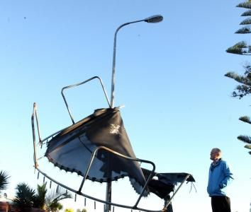 The force of the wind wrapped this trampoline around a lamppost. Photo: NZ Herald